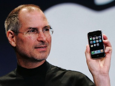 steve-jobs-holding-iphone-540x405